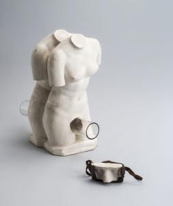 "Genpei AKASEGAWA""Homology (woman),"" 1964, plaster, glass, 30 x 53 x 55 cm""Homology (camera),"" 1964, plaster, camera case, 16 x 9 x 8 cmPhoto: Nobutada OMOTE | SANDWICH"
