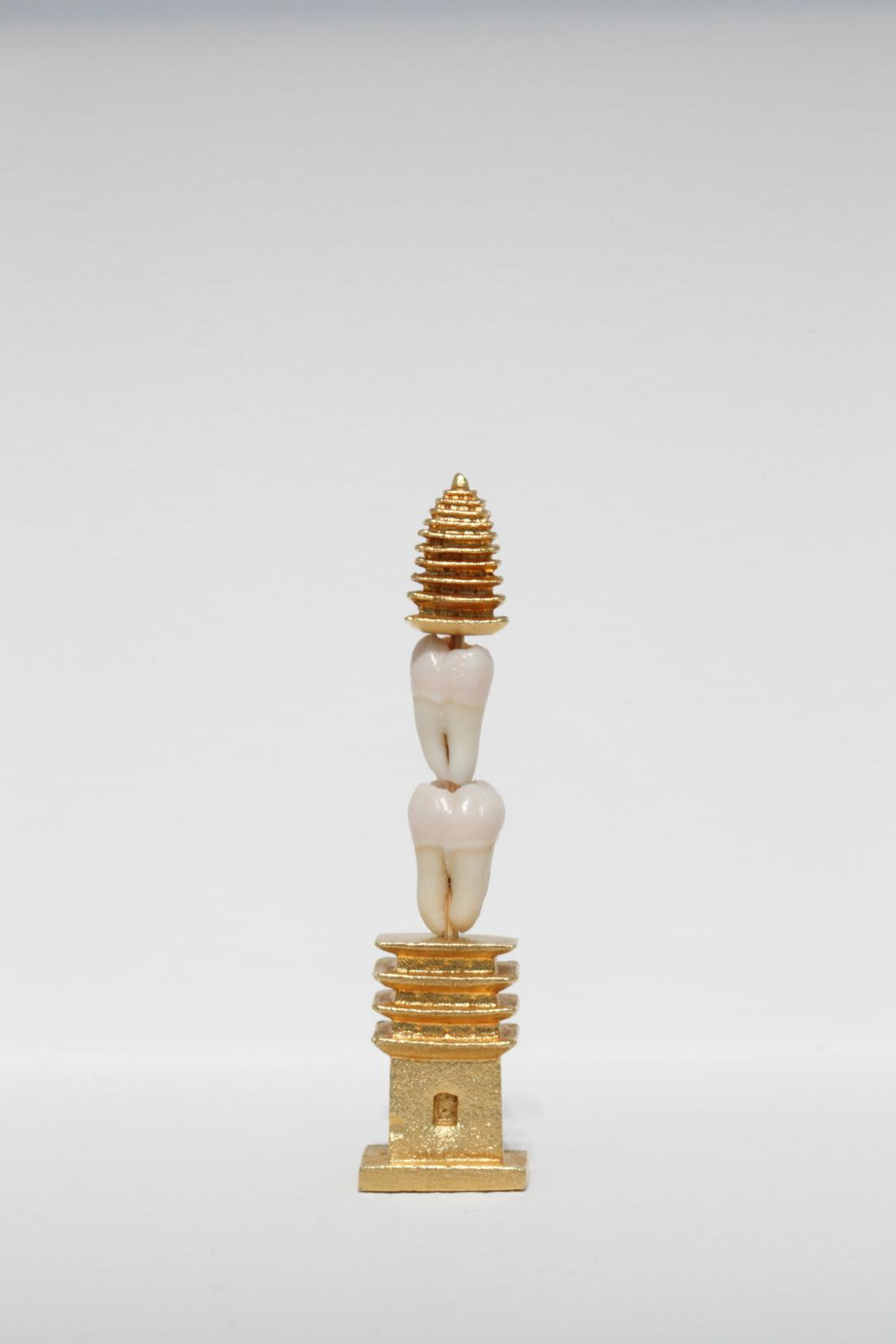 """Wisdom Tower (a pretty girl),"" 2013, tooth, gold, copper, bamboo stick, 8.25 x 2.1 x 2.1 cm<br>Photo: Keizo Kioku"