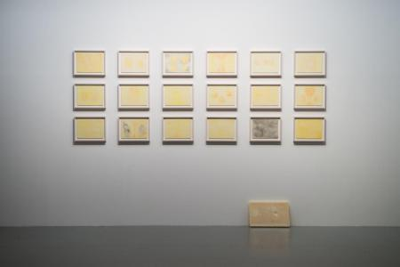 "He Xiangyu, ""Everything We Create Is Not Ourselves,"" 2014, watercolor on paper, set of 18, 23 x 31 cm each; ""Everything We Create Is Not Ourselves,"" 2014, wax, 29.5 x 47 x 5 cm; photo by Nobutada OMOTE 