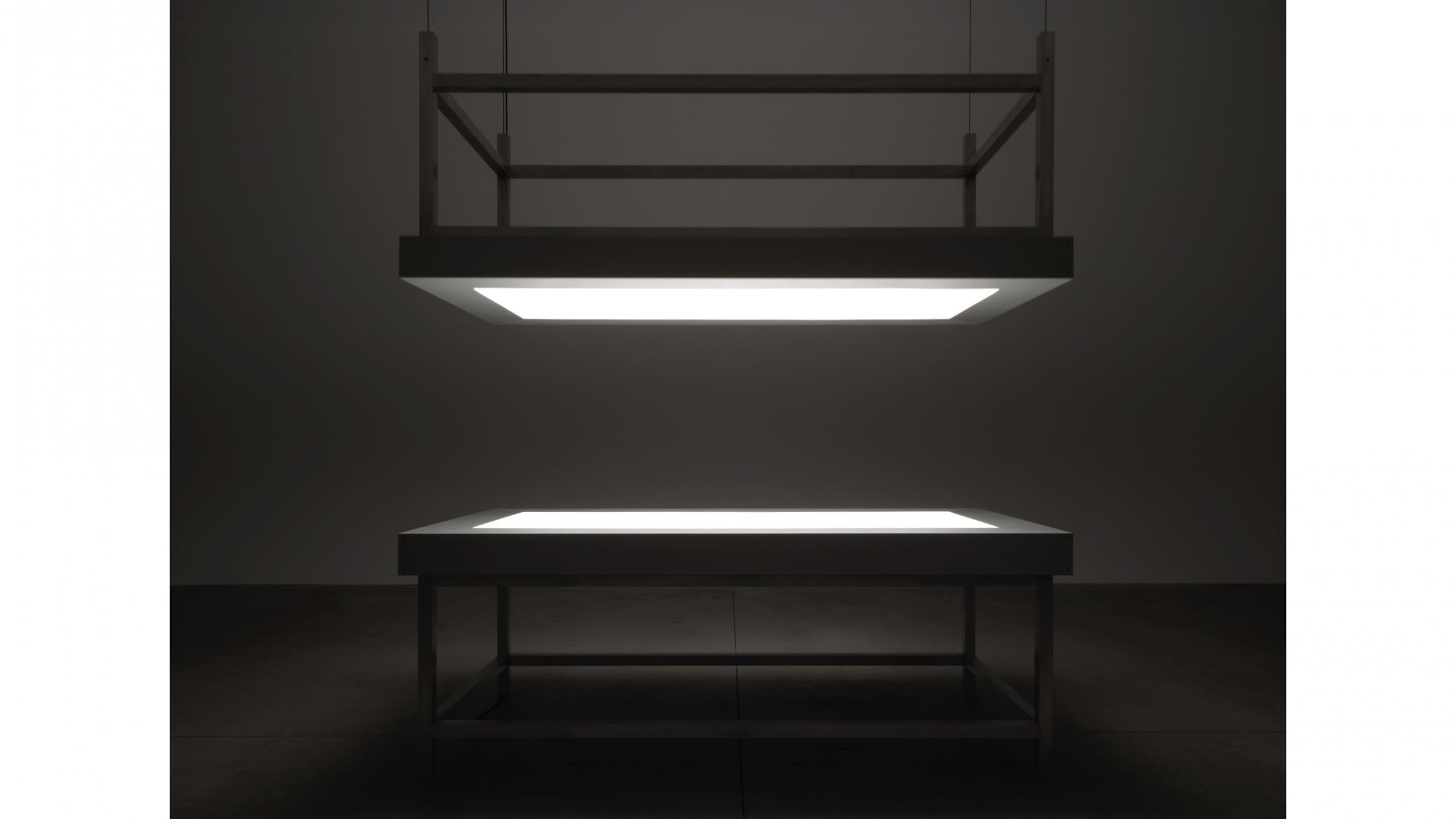 "Alfredo Jaar, ""Lament of the images"" 2002Two aluminum tables, glass, perspex, LED lights and motor420 × 244 ×122 cm"